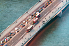 Traffic on a bridge of London. Night aerial view.  Royalty Free Stock Photos