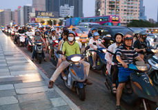 Traffic on the bridge through Love River. People are riding scooters - the most popular transport in Taiwan. Kaohsiung city, Taiwa Stock Photos