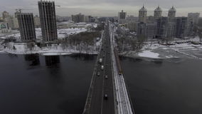 Traffic on the bridge, near the metro rides, shooting from the air stock footage