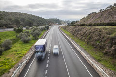 Traffic from bridge at spanish national road with slow vehicles. Car overtaking to truck that moves by slow vehicles lane. Cerro Muriano, Cordoba Stock Images