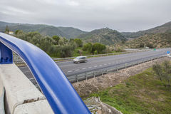 Traffic from bridge at spanish national road with slow vehicles. View of traffic from bridge at spanish national road with slow vehicles lane. Cerro Muriano Royalty Free Stock Image