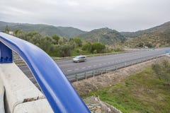 Traffic from bridge at spanish national road with slow vehicles. View of traffic from bridge at spanish national road with slow vehicles lane. Cerro Muriano Stock Photography