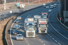 Traffic on the British motorway M25 in a sunset time. Stock Photo
