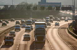 Traffic on the British motorway M25 in a sunset time. Royalty Free Stock Images