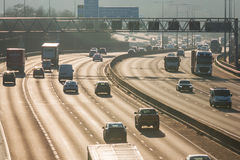 Traffic on the British motorway M25 in a sunset time. Royalty Free Stock Photos