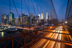 Traffic on the Brooklyn bridge with Lower Manhattan city skyline Stock Photo