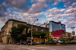 Traffic and buildings along North Avenue in Baltimore, Maryland. Stock Photography