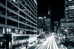 Traffic and buildings on Light Street at night, in downtown Balt Stock Photo
