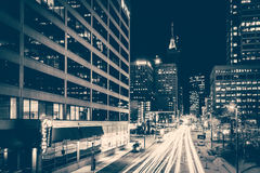 Traffic and buildings on Light Street at night, in downtown Balt Stock Image