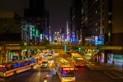 Busy intersection in Taipei at night. Traffic at a busy intersection in downtown Taipei, Taiwan, at night Stock Photography