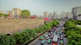 Timelapse Traffic on busy street near by xi`an city wall ,xian,shaanxi,China stock video footage