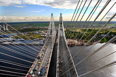 Traffic on cable-stayed bridge, view from the air. Royalty Free Stock Images
