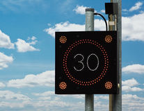 Traffic Calming speed sign. British traffic calming sign which flashes a drivers speed at them, if they are in breach of the legal limit, in order to reduce Royalty Free Stock Photos