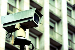 Traffic camera and building. Traffic camera on pedestal with a building in the background Stock Photography