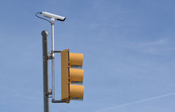 Traffic Camera And Traffic Light From Side. Side view of a traffic camera mounted with and above a traffic light royalty free stock photos