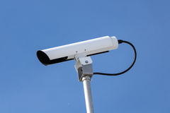 Traffic Camera. View of a traffic camera against blue sky Stock Photography