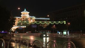Traffic of car bus and people from blazing lanterns streets of Night Beijing. Tram in a street of Night Beijing. Traffic movement of vehicles car bus and people stock footage