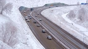 Traffic of cars on a highway at winter frosty morning in the city. Traffic of cars on a highway at winter frosty morning in the city 1 stock video footage