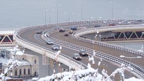 Traffic of cars on a highway at winter frosty morning in the city. Urban cityscape stock footage