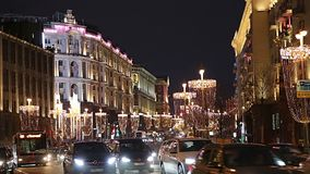 Traffic of cars in Moscow city center Tverskaya Street near the Kremlin at night, Russia. Christmas and New Year holidays illumination and Traffic of cars in stock video
