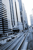 Traffic with cars motion blurred in Hong Kong stock photography