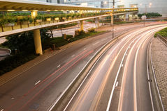 Traffic with cars motion blurred in Hong Kong stock images