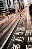 Traffic with cars motion blurred and mark. It is traffic with cars motion blurred and mark on the ground in Hong Kong Stock Photos