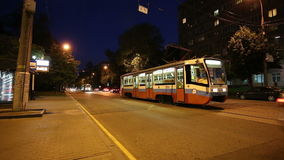Traffic of cars and trams in Moscow city center at night, Russia stock video