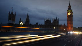 Traffic cars on the Westminster bridge with Parliament and Big Ben in background Stock Images