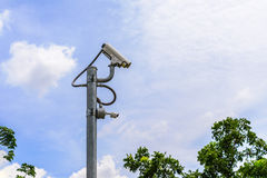 Traffic CCTV camera or Surveillance Operaiting on Blue Sky.  Royalty Free Stock Photography