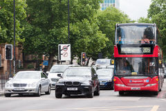 Traffic in central London. A double decker bus to Paddington, a BMW suv and a Mercedes car wait for the  green light in Marleybone Rd in London on August 9, 2013 Stock Photography