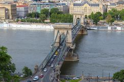 The traffic on the Chain bridge in Budapest with Gresham Palace in the background stock photography