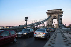 Traffic on the Chain Bridge in Budapest. Opened on 20 Nov 1849, Bridge became one of incentives of unification of Buda Royalty Free Stock Image