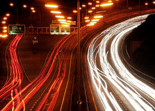 Traffic chaos at night. Busy road at night. Long exposure leaving streaking light trails Royalty Free Stock Photo