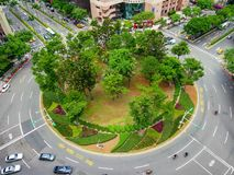 Traffic circle with green design in center, Taiwan. stock image