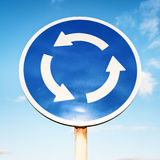 Traffic circle sign. In front of sky Stock Photography