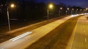 Traffic in the city. Avenue Time-Lapse. Traffic in the city. Long Exposure Time Lapse of Night Traffic in Vilnius, Lithuania. High-angle view from a bridge stock video