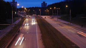 Traffic in the city. Avenue Time-Lapse. Traffic in the city. Long Exposure Time Lapse of Night Traffic in Vilnius, Lithuania. High-angle view from a bridge stock video footage