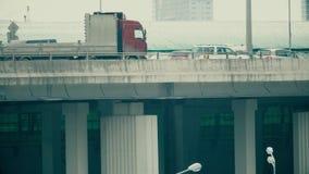 Traffic on a city car bridge. Telephoto lens pan shot