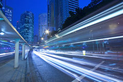 Traffic in city at night in blurred motion. It is in blue toned Stock Images