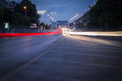 Traffic on city road through the bridge at twilight in Thailand. Royalty Free Stock Photos