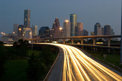Traffic and city skyline. Houston Traffic and the City skyline around nightfall Stock Images