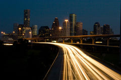 Traffic and the City skyline at Night Stock Photography