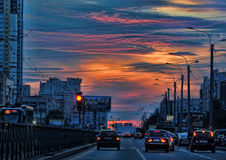 Traffic in the city at sunset Royalty Free Stock Images