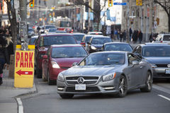 Traffic in the city of Toronto, Canada. Park sign Royalty Free Stock Photo