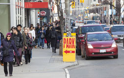 Traffic in the city of Toronto and citizens, Canada. Park sign royalty free stock images