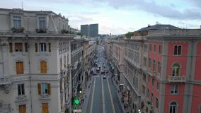 Traffic and clouds running fast in the center of Genoa stock video