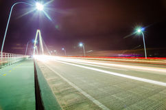 Traffic commute on bridge at night long  exposure Stock Photography
