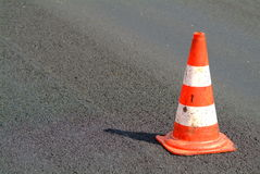 Traffic cone. A red white brindled traffic cone on street stock photos