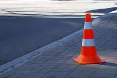 Traffic cone. On the road Royalty Free Stock Photo